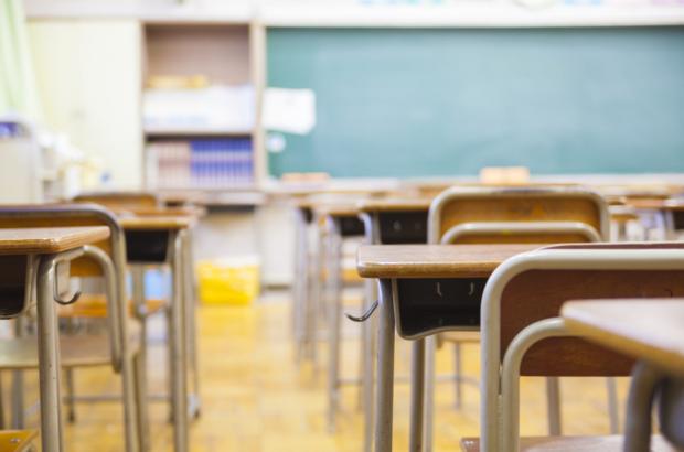 An empty school classroom defocused.
